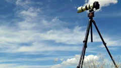 Timelapse of the professional camera on a tripod shooting cloudscape Stock Footage