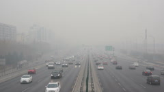 Cars driving on a heavy hazy day in Beijing Stock Footage