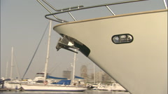 Close pan around a cruise ship, while buildings are seen on the shore in Dubai. Stock Footage