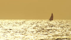 A sailboat passes on the sea. - stock footage