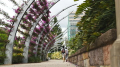 Stock Video Footage of Couple walk through Southbank in Brisbane