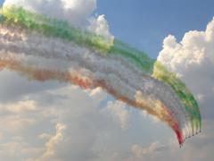 Frecce Tricolori on Aermacchi MB-339 with smoke trace - stock photo