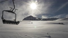 Empty Ski lift in movement with the sun Stock Footage