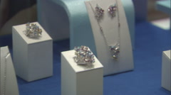 Pan across Jewellery on display at a store. - stock footage