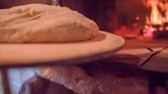 Bough going in to the bread oven - stock footage