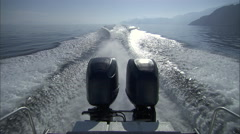 Shot at the rear end of a boat as it sails. Stock Footage