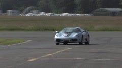 Blue Ferrari 430 on a race track Stock Footage