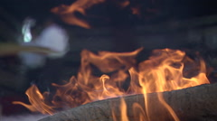 Close shot of flames rising from a camp fire. - stock footage