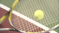 Close up of  tennis ball bouncing on a racket. Stock Footage