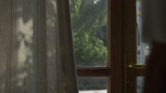 Close up of a man opening a door and looking outside. Stock Footage