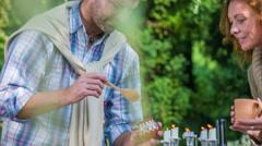 Man sweeten the tea with honey   - stock footage
