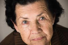 Portrait of grandmother looking nostalgic at camera Kuvituskuvat