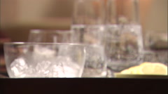 Lime put into glasses of water. Stock Footage