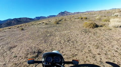 Viewpoint Riding Motorcycle Across Mohave Desert Plain Stock Footage