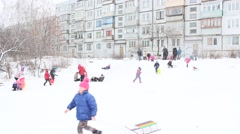 Children are sleding from the hill Stock Footage