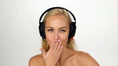 Beautiful female in headphones listening to the music with fluttering on the - stock footage