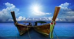 thai andaman long tailed boat southern of thailand on sea beach with beautifu - stock photo