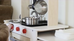 A cute boy playing with a toy kitchen Stock Footage