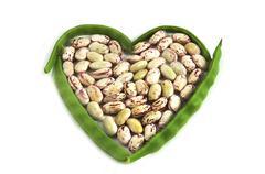 Organic string beans on white background; Stock Photos