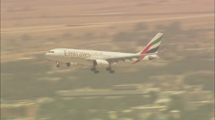 An Emirates plan lands at Dubai airport. Stock Footage