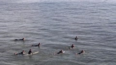 Pan Shot of Surfers Swimming Stock Footage
