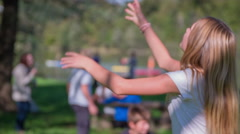 Girl playing with hula-hoop Stock Footage