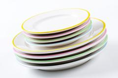 Set of rimmed plates with pastel colored edges Stock Photos