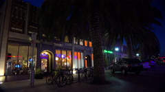 Establishing shot of a small retail business district at night. Stock Footage