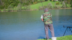 A man fishes in the lake Stock Footage