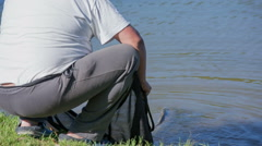 Man relishing the fish beck in to the water  Stock Footage