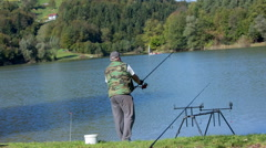 Man fishing at the local lake Stock Footage