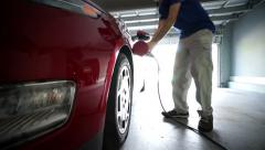 Electric Vehicle in garage Stock Footage