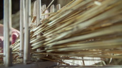 Straw going trough the wooden tool Stock Footage