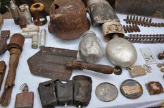 Pieces of old weapon found on the battlefield - stock photo