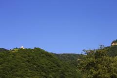 Stock Photo of Lonely distant monastery on the top of mountain