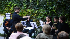 Concert wind quartet, saxophone, flute, clarinet director and baton. Stock Footage