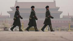 Soldiers on duty on Tiananmen square on a heavy hazy day in Beijing Stock Footage