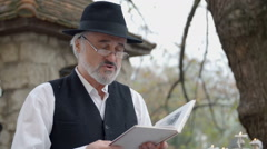 Man reading a poem out-laud Stock Footage
