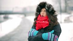Stock Video Footage of Woman standing in the park and warming up hands