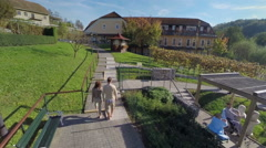 Couple walks around the therapeutic park Stock Footage