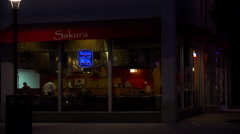 Exterior of a Japanese sushi restaurant at night. Stock Footage