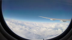 Timelapse 4K View through an airplane window airplane wing above the cloud -Dan Stock Footage