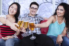 Multiracial friends toast with beer Stock Photos