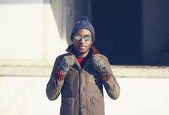 Fashion, clothes and people concept - stylish young african man outdoors - stock photo