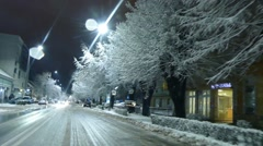 Driving Through The City Main Street In Winter - Street Covered in Snow  Stock Footage