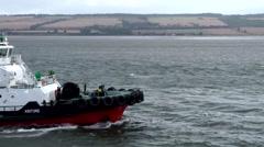 Scotland city of Invergordon 019 eastern Scottish shore behind tugboat Stock Footage