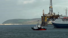Scotland city of Invergordon 017 passenger ship and oil rig Stock Footage