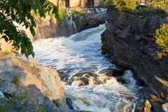 Fast flowing water in rapids Stock Photos