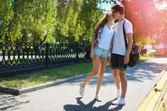 Couple teens in love walking in the park in summer day, youth, love, relation Stock Photos
