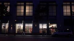Establishing shot of a retail business establishment at night. Stock Footage